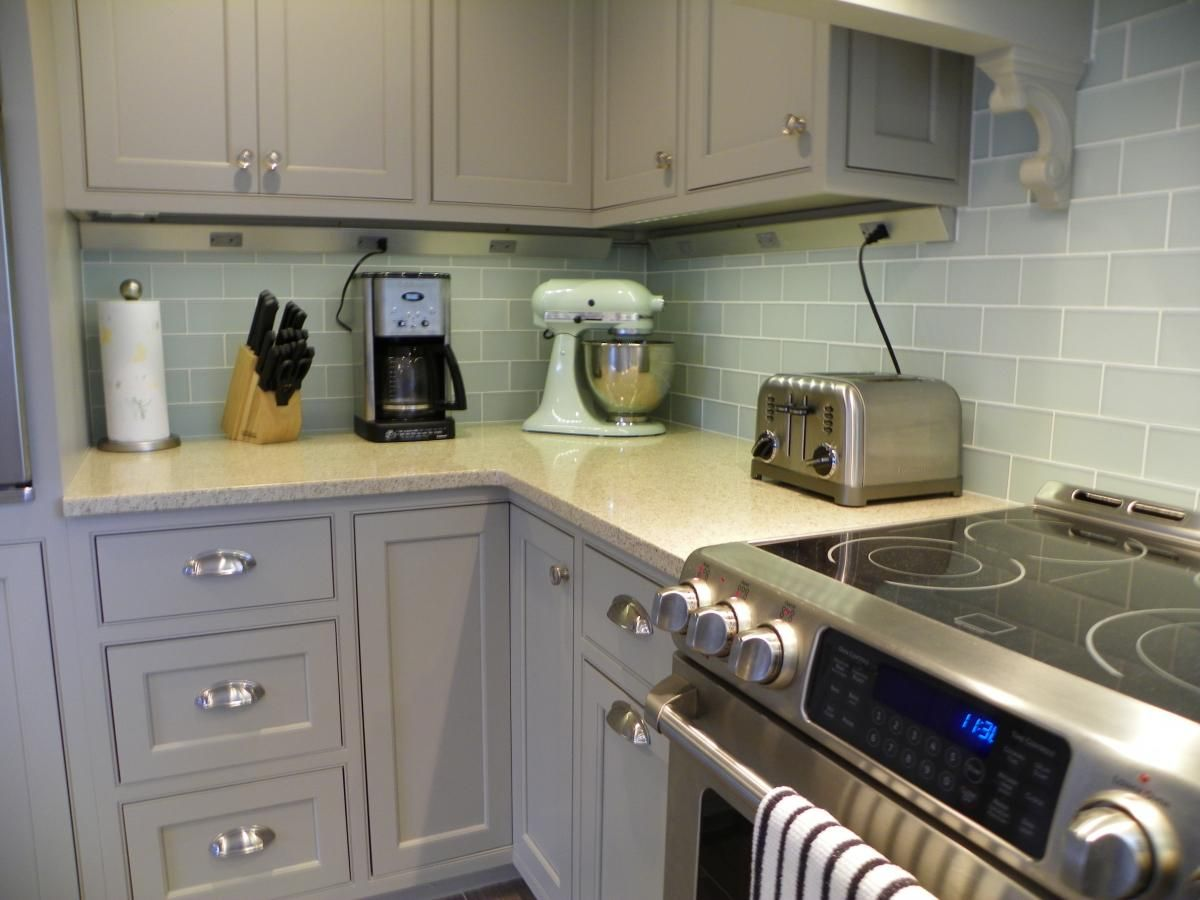 Pair Gray Cabinets With Warm Colors And Materials Gray Can Appear Austere And C Kitchen Backsplash Designs Kitchen Cabinet Styles Grey Tile Backsplash Kitchen