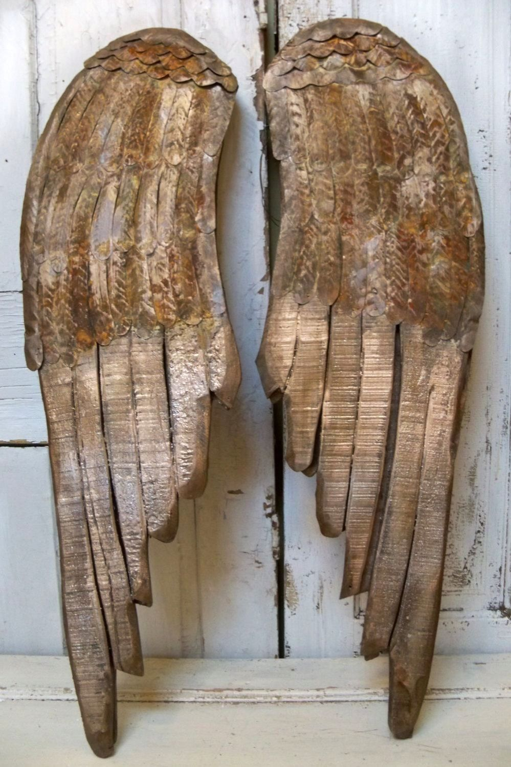 Large wooden wings wall sculpture rusty metal distressed faux finished hand carved home decor Anita Spero. $189.00, via Etsy.