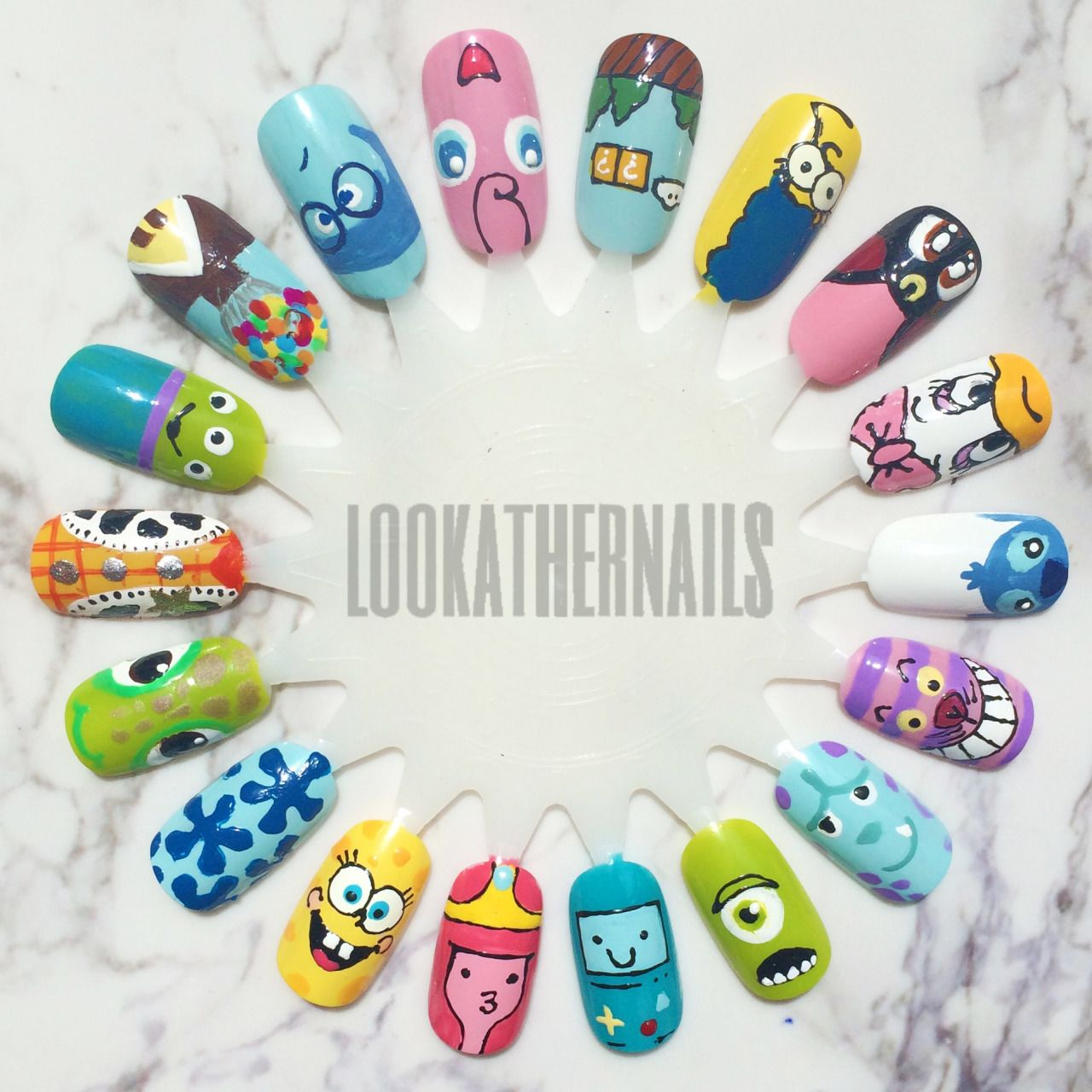 Character Design Nail Art : Cartoon nail art wheel featuring characters from disney