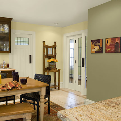 Pale colors whitewashed surfaces warm wood tones and Benjamin moore country green