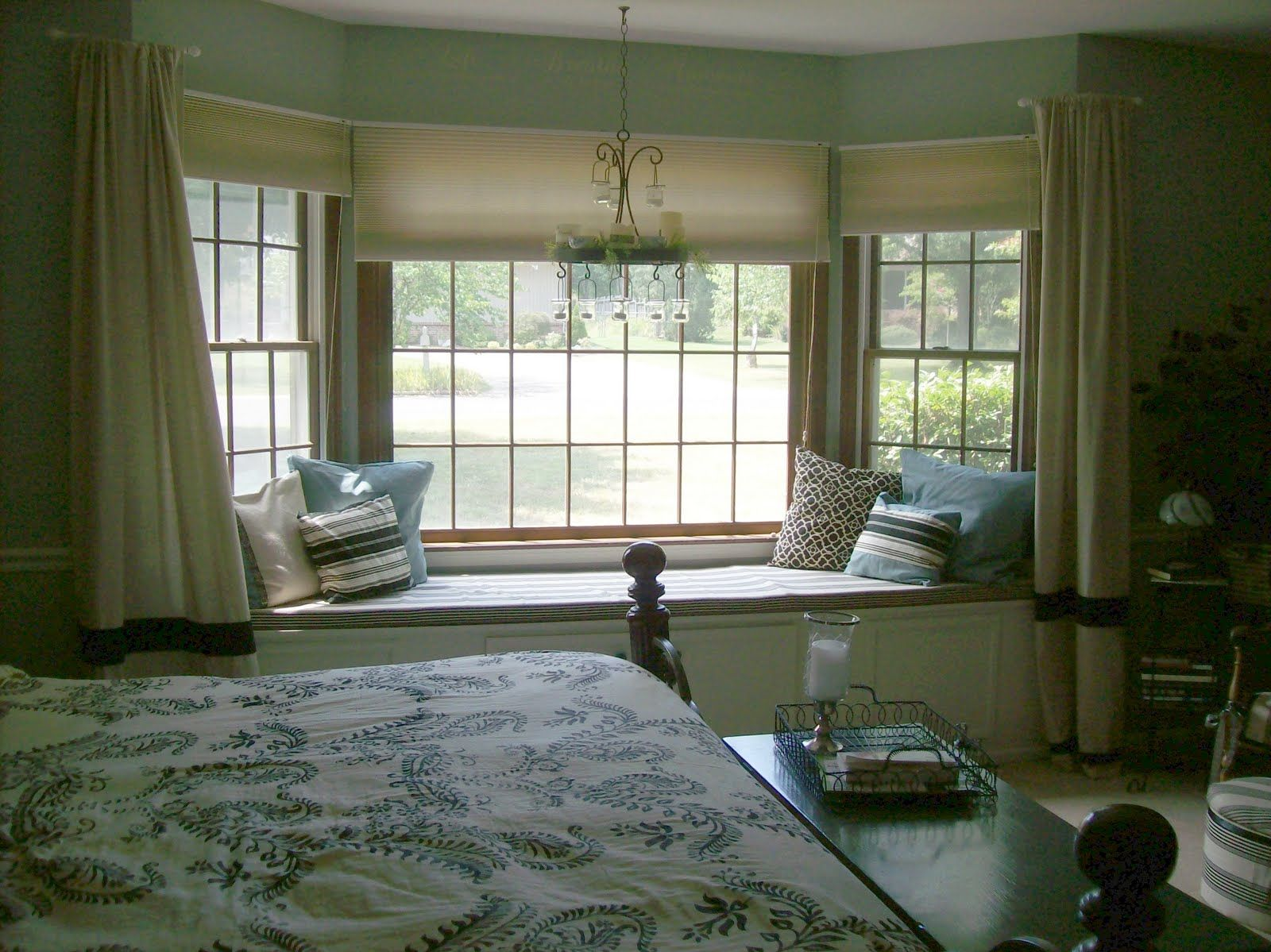 Remarkable brown bedroom bay window design idea with cream for Sitting window design