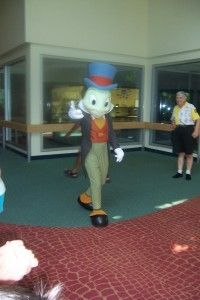 Jiminy Cricket at DAK at Conservation Station. Such an OLD picture by the attendant attire- and I spy an old friend who is attending him! :D