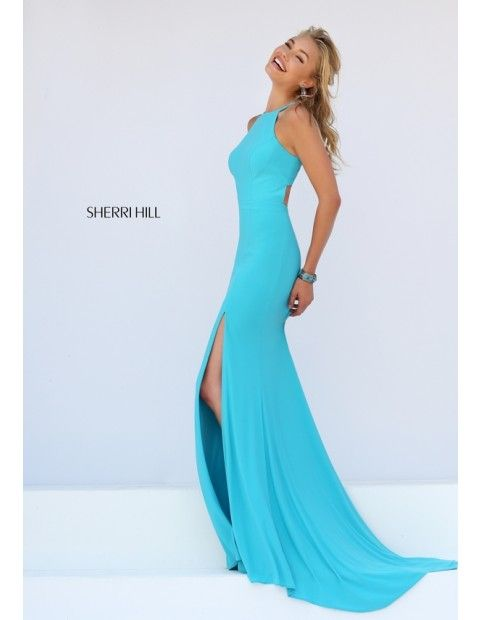 Smooth slim line elegance emanates from the Sherri Hill 32340 full-length prom  dress. This jersey jersey gown showcases a high halter neckline and inset  ...