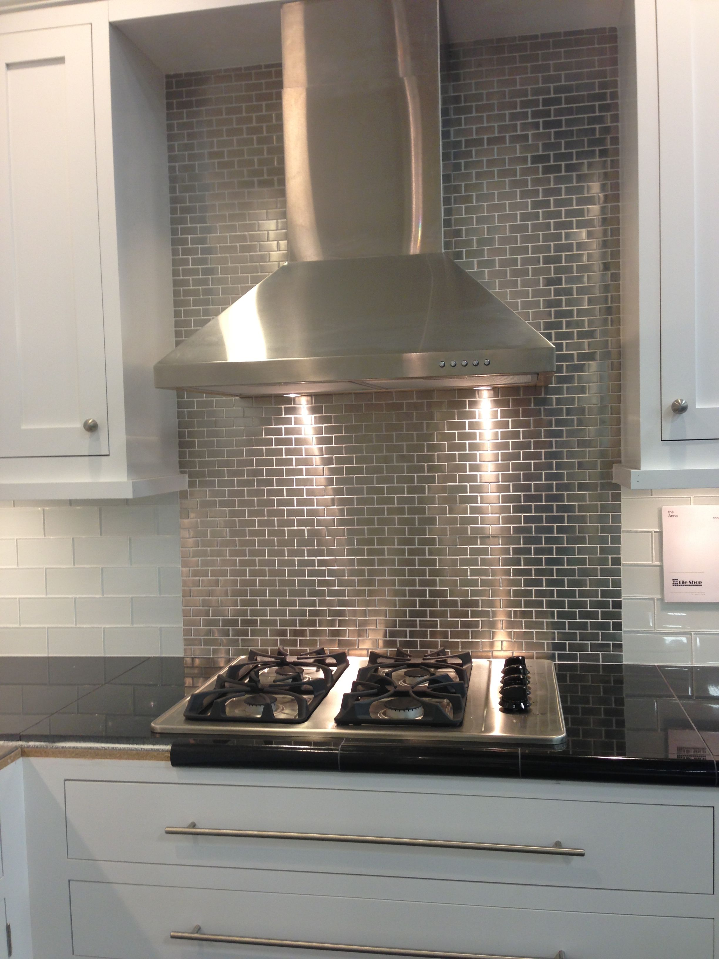 Stainless steel tile backsplash perhaps for an in kitchen bar area