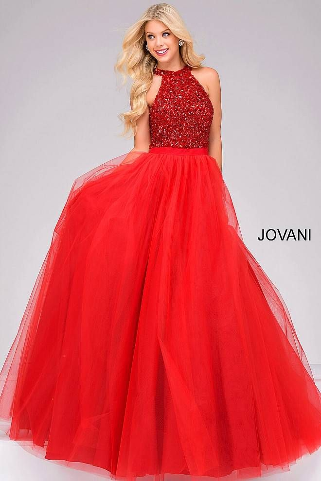 f5a419385f06 Floor length red ballgown features a bead embellished bodice with a halter  neckline