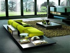 Modern living room - great use of elongated planes and spicy usage of the one color.