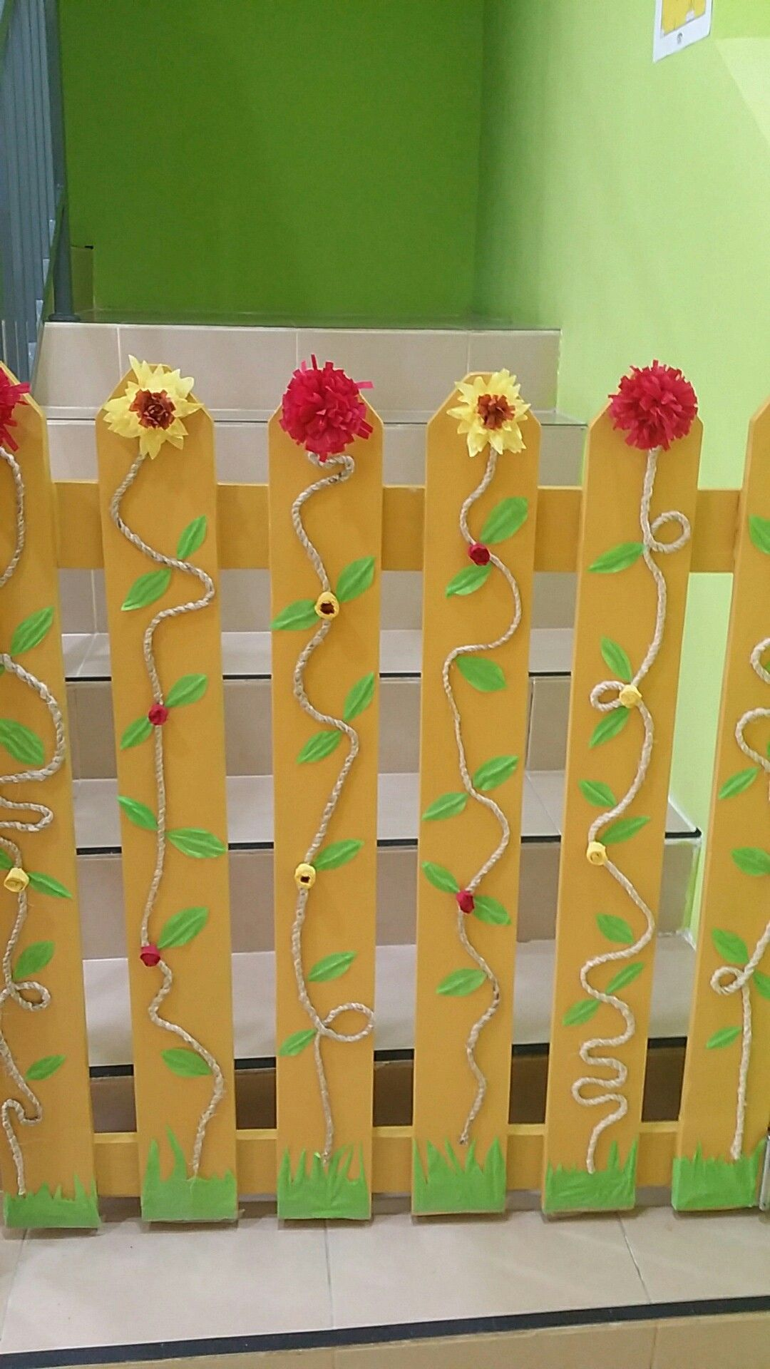 Flower decorations on wooden gates. Materials: Rope, Crepe Paper ...