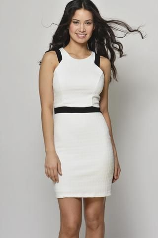 We all love a little white dress! This fitted white dress with black detailing is a great choice for a party or night out! This mini white dress has a zip up back. You will Own the Night in this white