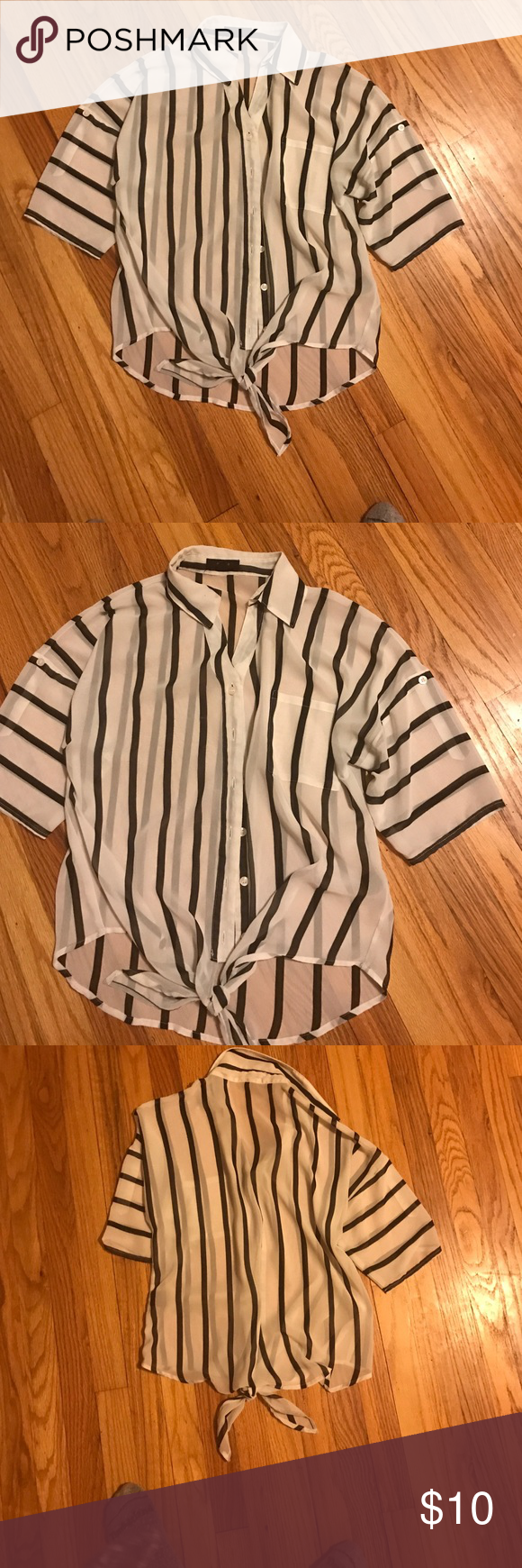 Short sleeve tie blouse Black and white short sleeve blouse that ties in the front of the top. It is sheer material and fits comfortably at a good length. The shirt is a size medium. Tops Blouses