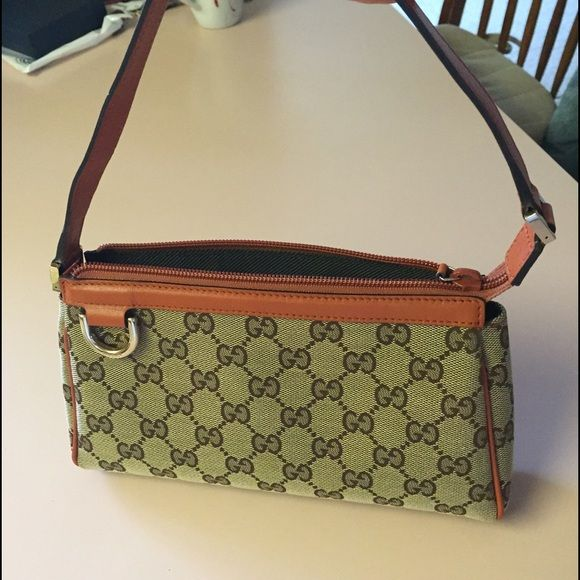 fba9ad169d5 Gucci bag GUCCI Monogram D Ring Pochette. The traditional features and  exceptional quality of this