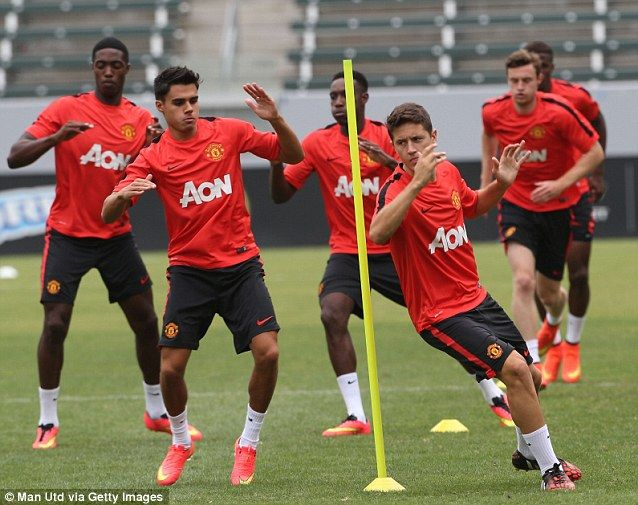 Agility: Ander Herrera, right, gets a chance to show his fitness in front of his new coach...