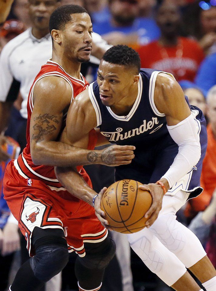 678c575edd5 Oklahoma City s Russell Westbrook (0) tries to take the ball past Chicago s  Derrick Rose (1) during an NBA basketball game between the Oklahoma City  Thunder ...