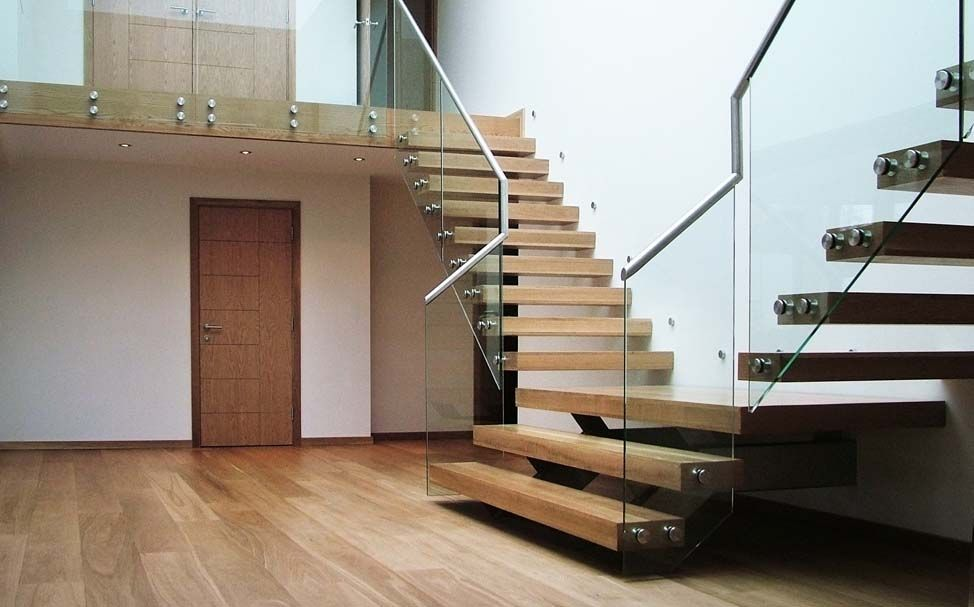 Cantilevered timber stairs appear to be floating stairs for Steel mezzanine design