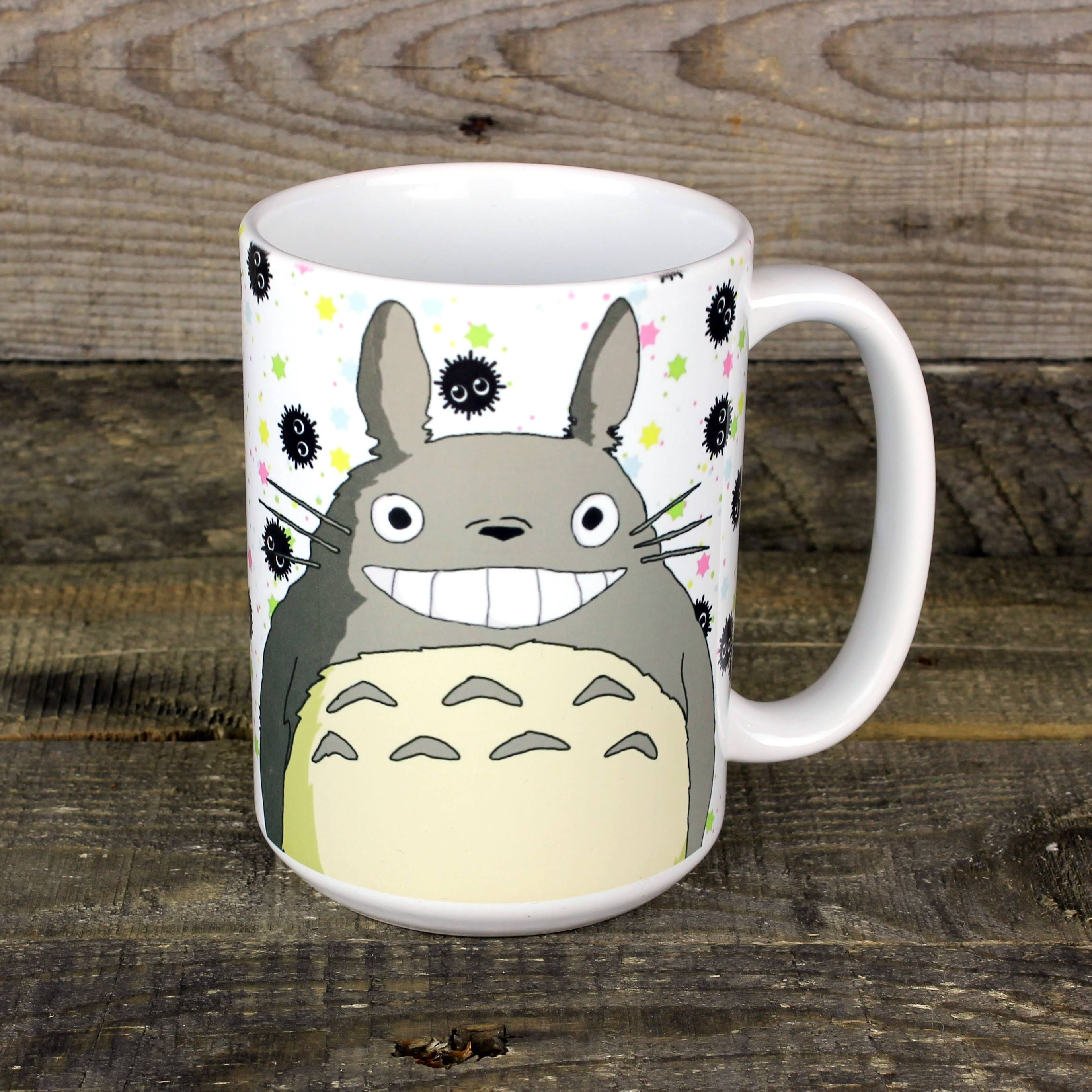 15 oz mug featuring the ever adorable Totoro. Microwave safe. You can run it baff66f5e6