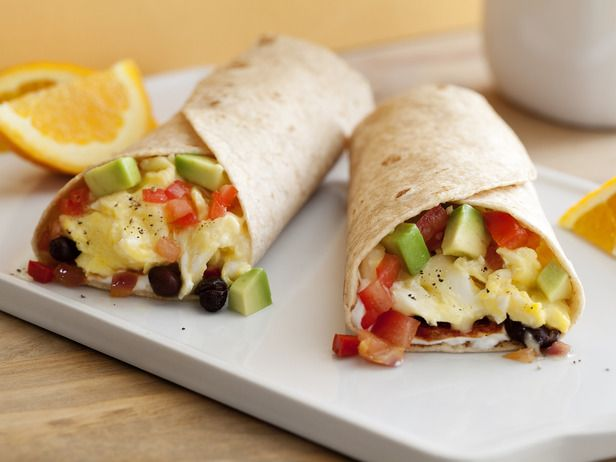 Healthy breakfast burrito with peppers, black beans, avocado and cheese.