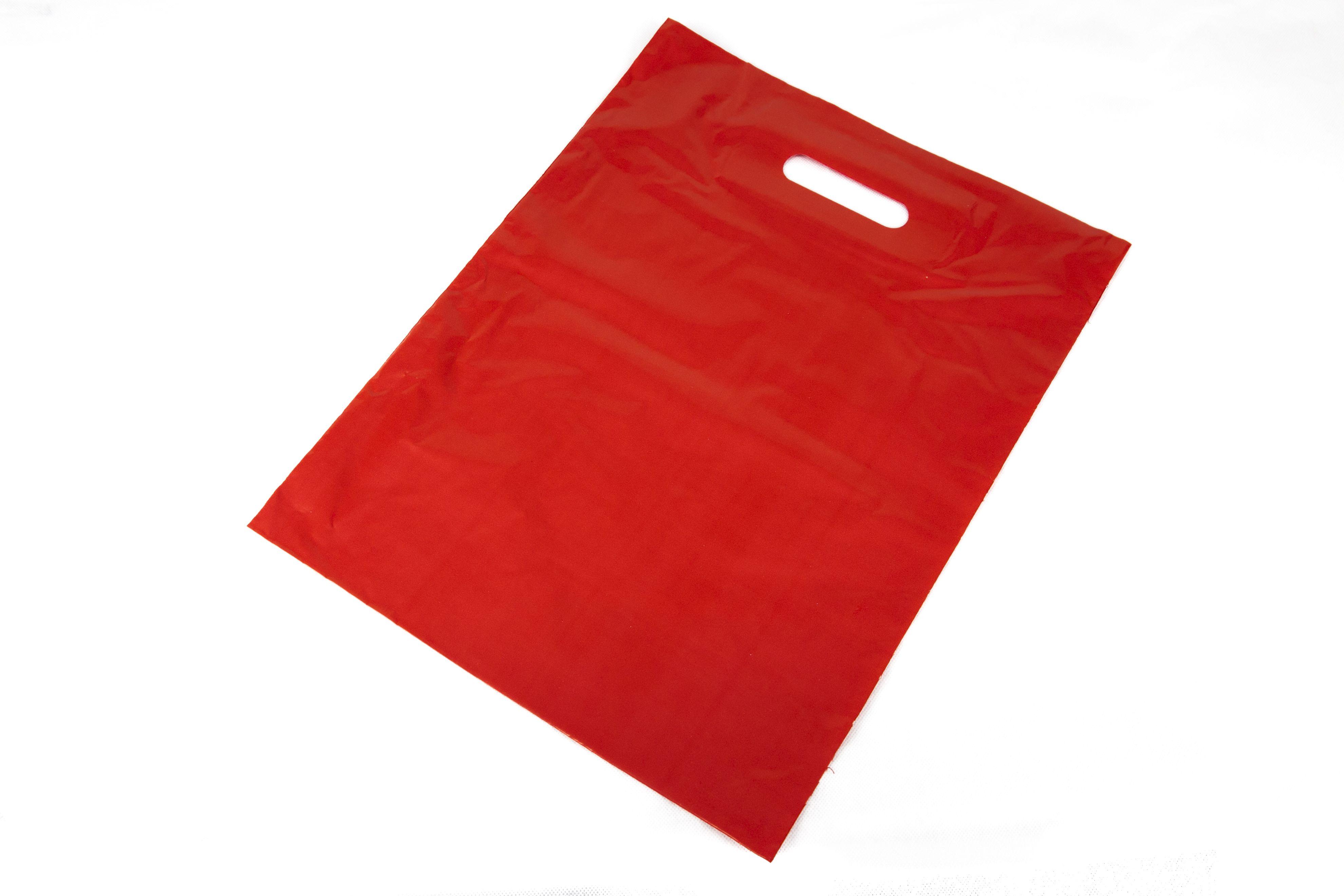 93cefed84 Bolsa de plástico color rojo con asa troquelada. Perfecta para todo tipo de  comercios como