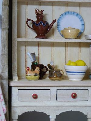 I thought I'd give you a closer look at the dresser in the kitchen.  The dresser was just a simple whitewood one, that I'm sure you...