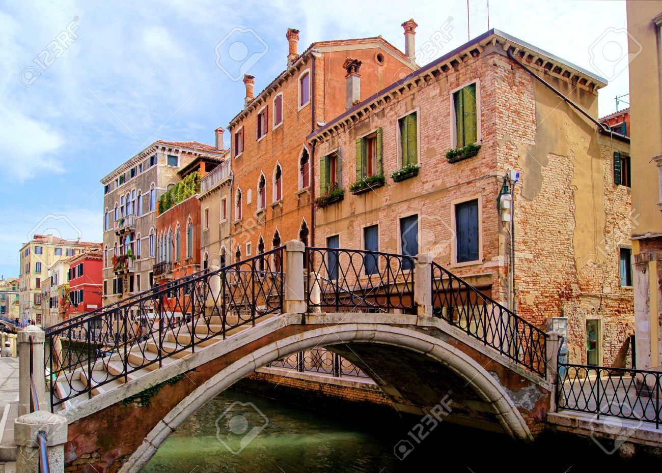 Bridge And Architecture Along The Canals Of Venice, Italy Stock .