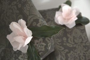 Tissue paper flowers and real magnolia leaves