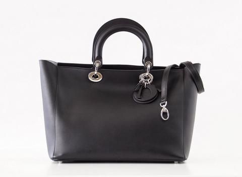 149865b6b Guaranteed authentic CHRISTIAN DIOR large Diorissimo black leather tote bag.  Signature logo charms in black.