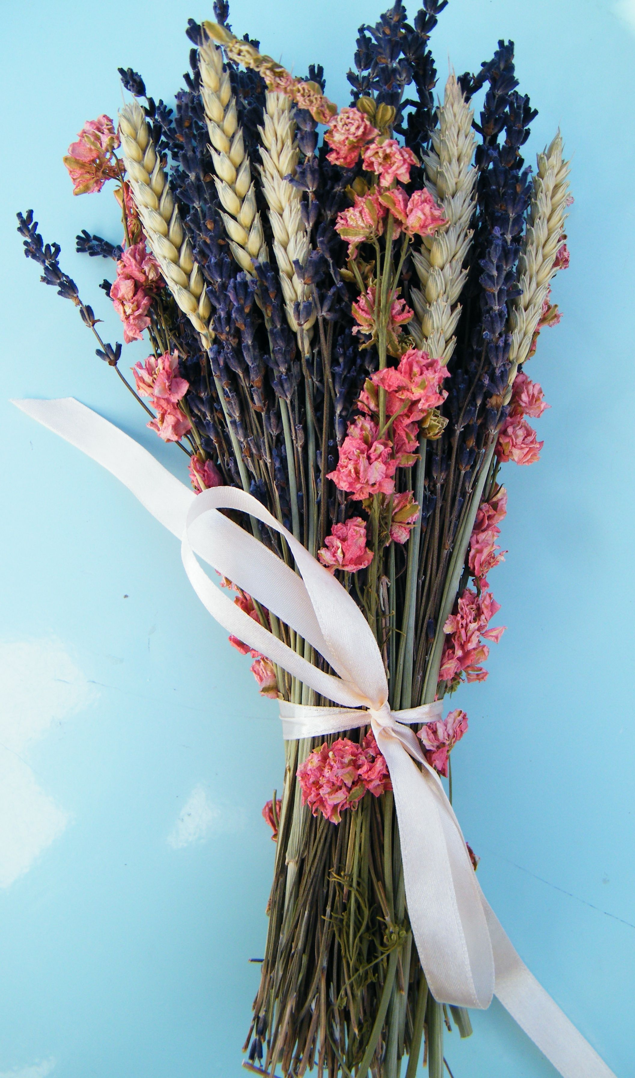 Dried flower bouquet with lavender flowers, pink delphinium and ...