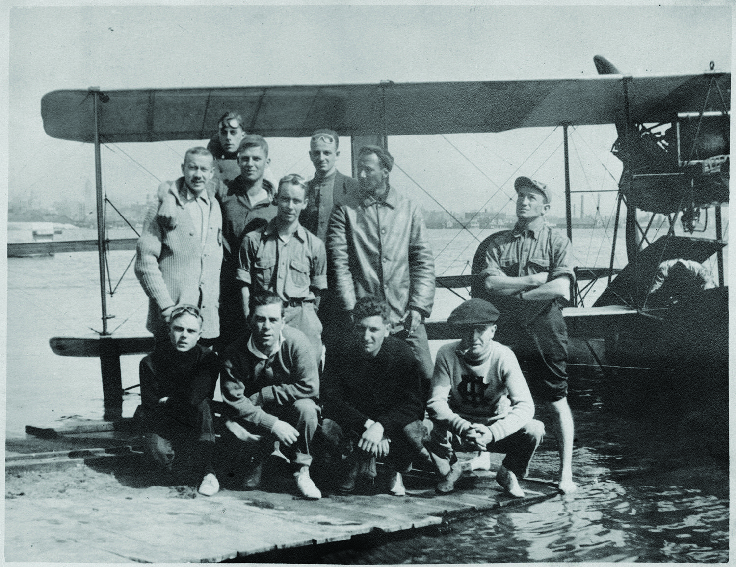 Before founding our Credit Union in 1936, Victor Vernon was a  civilian flight instructor for aviation pioneer Glenn H. Curtiss.  Vernon (looking left below) poses with some of his student pilots in front of a Curtiss F Boat type plane at the Curtiss Aviation School circa August 1915 at Toronto Island in Toronto, Canada. Photo courtesy of the Smithsonian National Air and Space Museum.