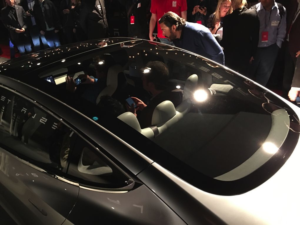 The Tesla Model 3 is here — sort of. It won't actually ship to the thousands of customers with preorders until late 2017, but we finally have our first look at it, even if Elon Musk says this is...