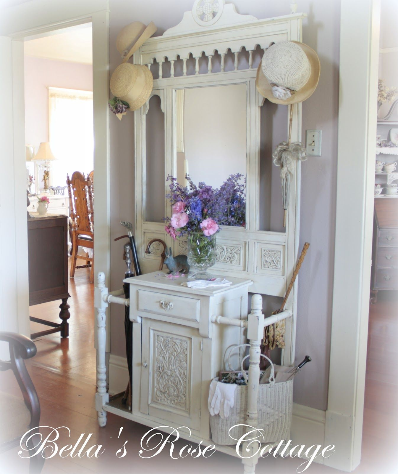 Shabby Chic Foyer With Vintage Hardware