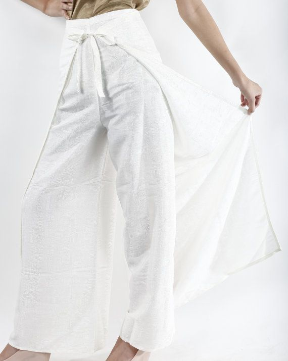 1856e4b6861 White palazzo wrap pants that ties in the front and back to allow for a  perfect fit. High waist and wide legged. One size fits most