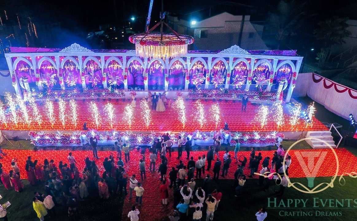 A wider look at our magical stage decor shows up a fluid combination of design asthetics , a colorful lit up exterior in sync with a Royal Palace vibe ✨   Follow us for more ideas ✨  #weddingdiaries   #decor #happyevents #weddingideas  #eventplanner #eventplanner #pyro #stageset #royalweddings