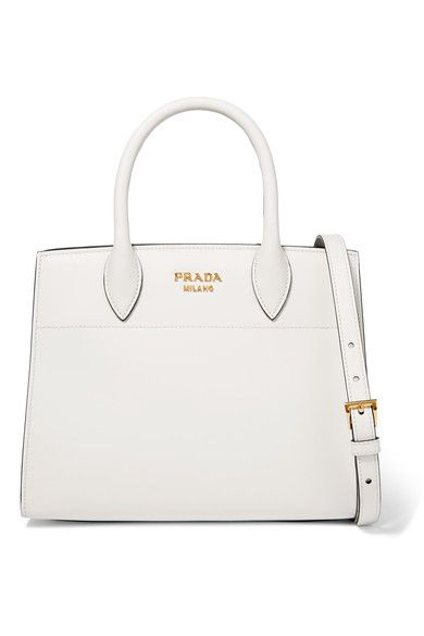 1694bcff06d6 Miuccia Prada elevates the ordinary with this timeless  Bibliothèque  tote  - trimmed in beige and light-brown watersnake at its concertina sides.