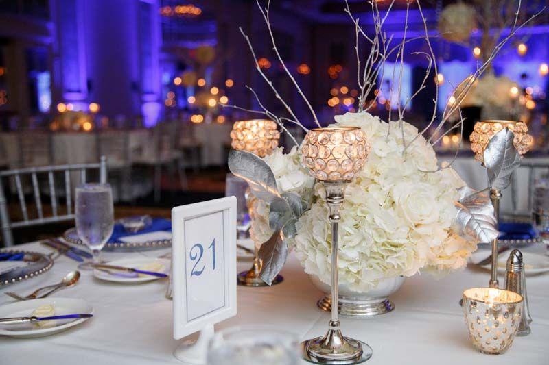 White and silver floral centerpiece decor loews portofino bay white and silver floral centerpiece decor loews portofino bay wedding orlando wedding photo junglespirit Gallery