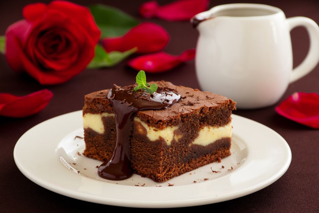 Chocolate brownie with cheese filling and chocolate sauce