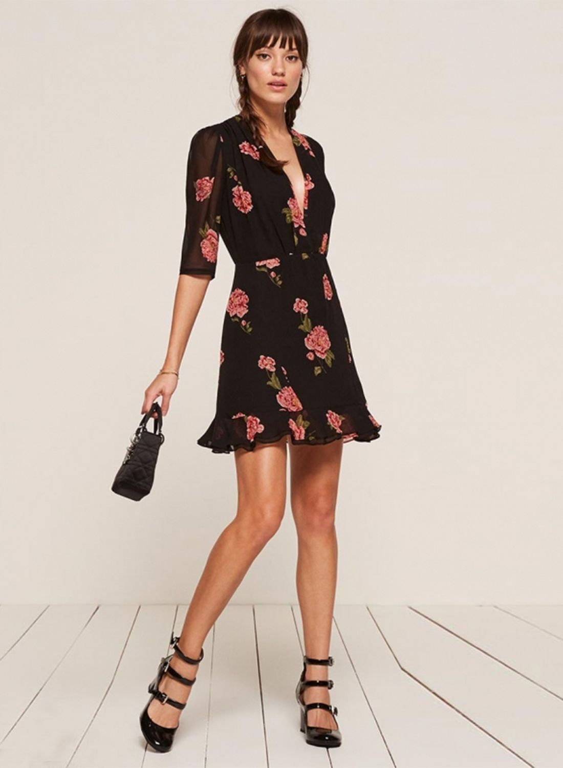 The black color dress is featured v neck, half sleeve, floral print, zipper, flounce panel.