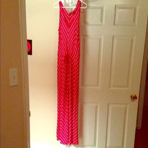 Red & white striped maxi dress Comfy sleeveless maxi dress. Can tighten around waist with tie. Long- goes to shoes (I'm 5'7). Only worn a few times. Dresses Maxi