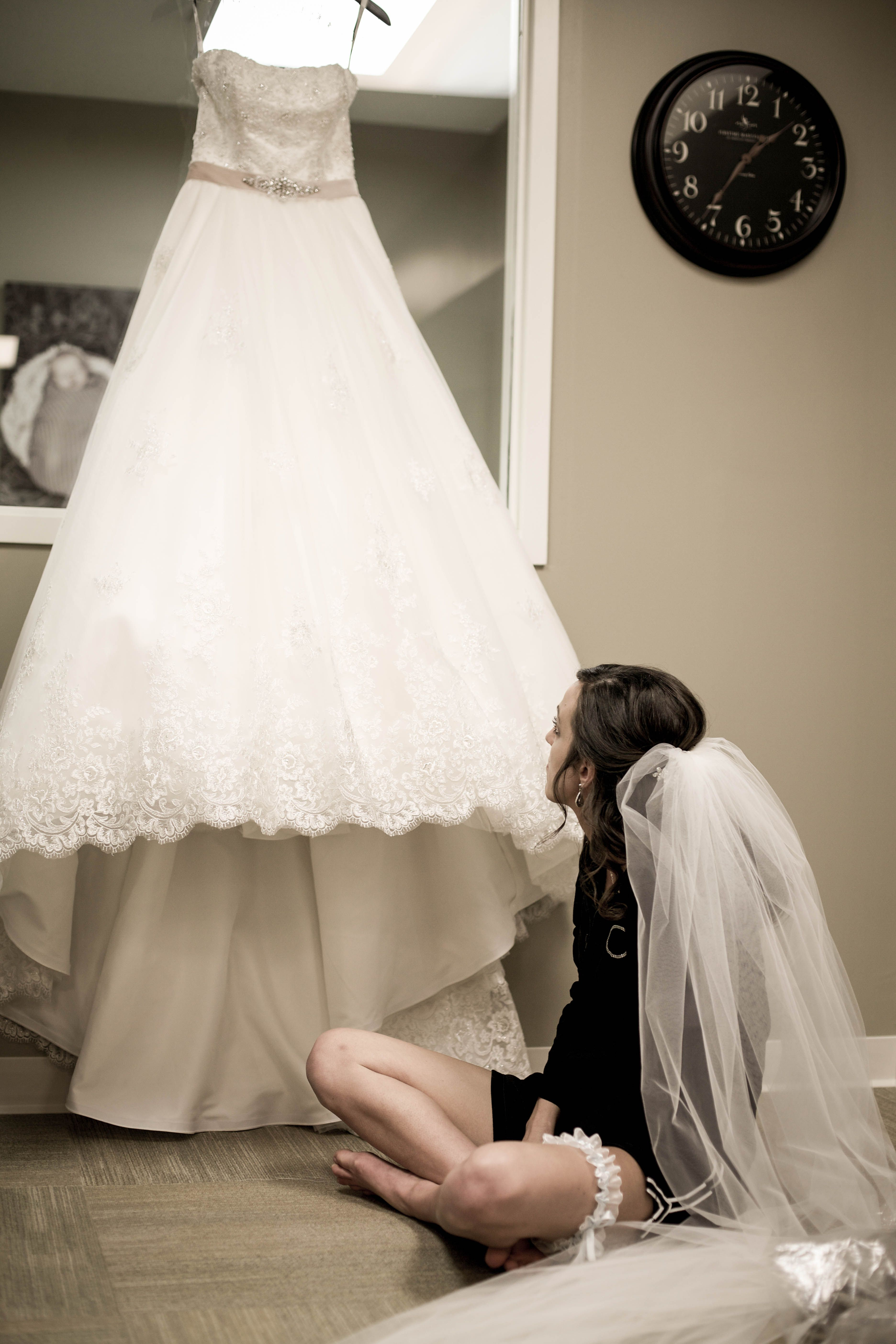 bride and her wedding dress before the wedding vintage
