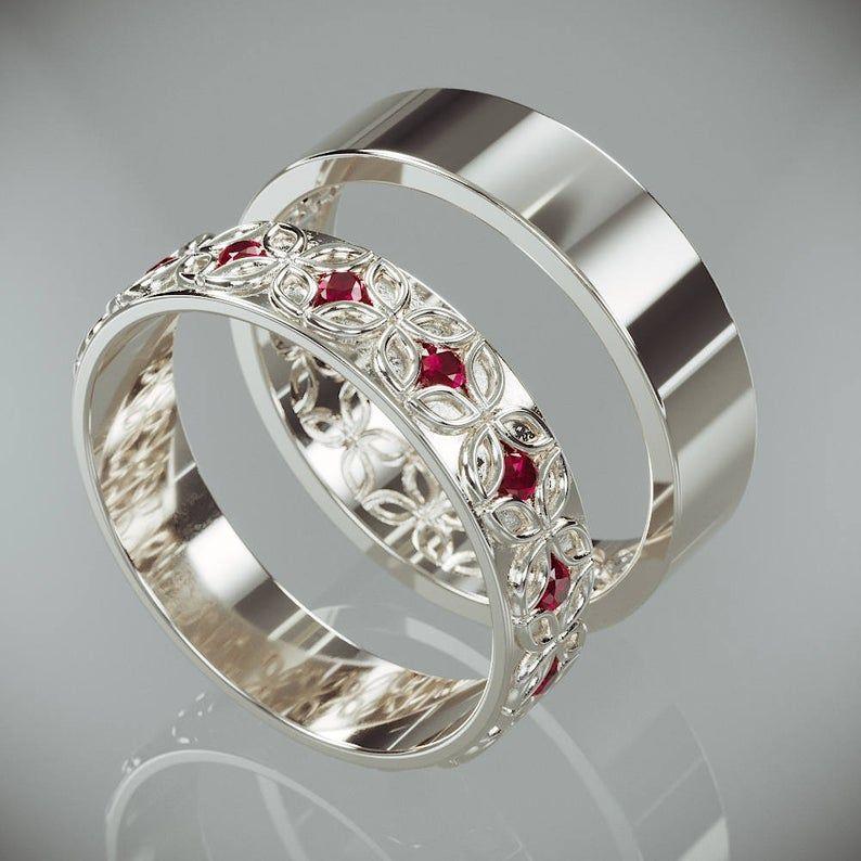 14k white gold celtic flower wedding rings set with ruby