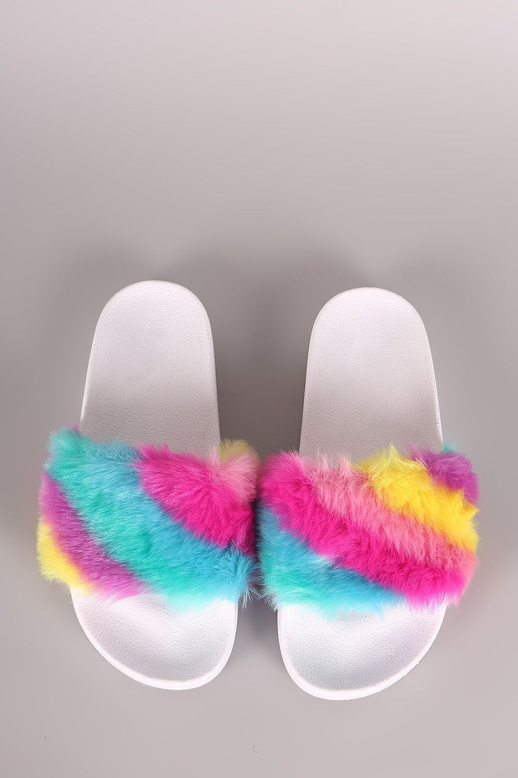 adae626d2115 This bold sandal features a wide fabric-lined band with fuzzy faux fur trim  finish. Easy slip-on style. Material  Faux Fur (man-made) Sole  PVC  Measurement ...