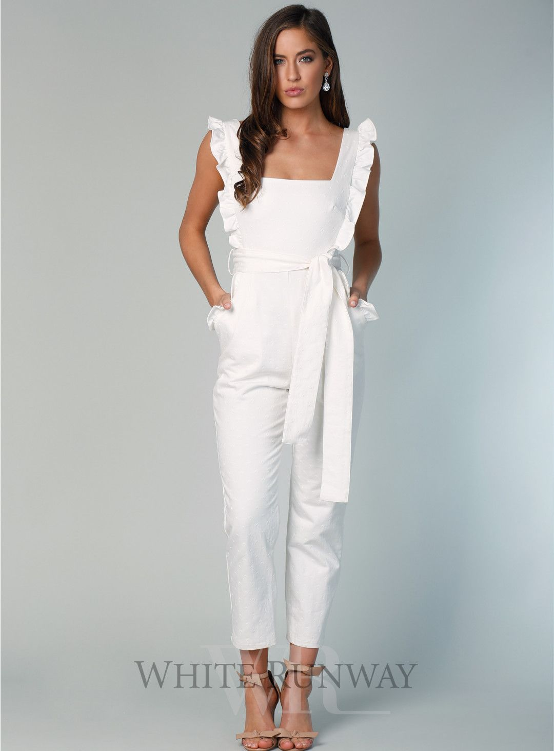 bf1e9e15ba1 Pre-Order Getaway Girl Jumpsuit. A chic jumpsuit by Pasduchas. Featuring a  square neckline and ruffle details on the arms and pockets.