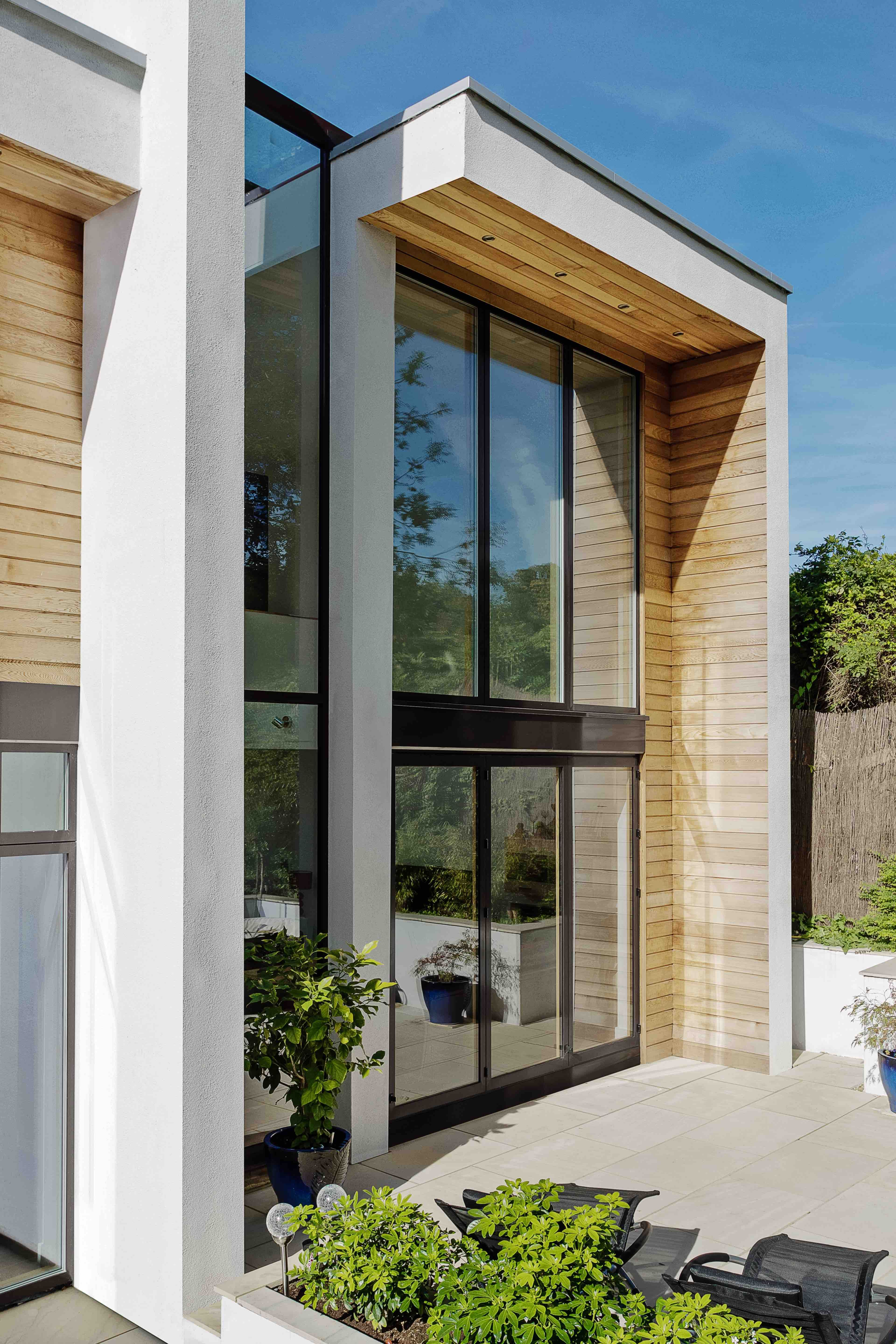 This storey house with flat roof comprises of long  wrapping elements also rh co pinterest