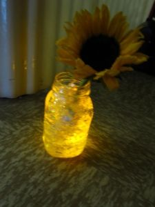 Use LED submersible lights to light up a vase with iridescent paper