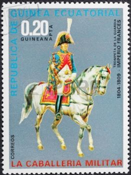 REPUBLIC OF EQUATORIAL GUINEA Guinea - CIRCA 1976: A postage stamp printed in the Equatorial Guinea shows army uniform of military cavalry - trumpeter of French Empire Guard in 1804-1809, circa 1976 photo