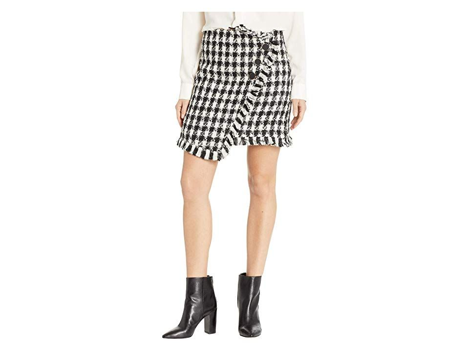 J.O.A. Tweed Mini Skirt (Black/White) Women's Skirt. Turn up the sass with this J.O.A. Tweed Mini Skirt. Cozy tweed fabrication boasts a houndstooth-inspired print throughout. Wrap-silhouette with fringe trim. Fitted waist with concealed side zip closure. Double-button accent at front. Asymmetrical hemline. 80% polyester  20% acrylic. Dry clean only. Imported. WARNING Measurements: Skirt Length: 17 in Waist Measurement: 26 in