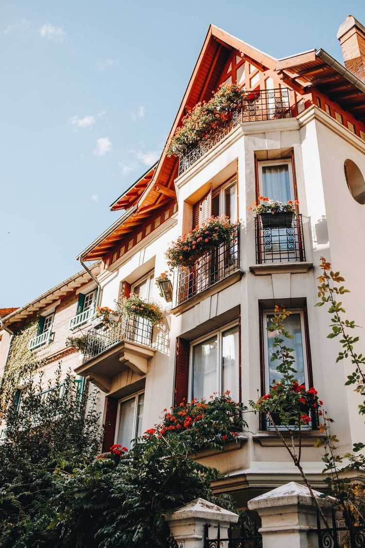 Stunning French Architecture With Balconies And Rose Vines