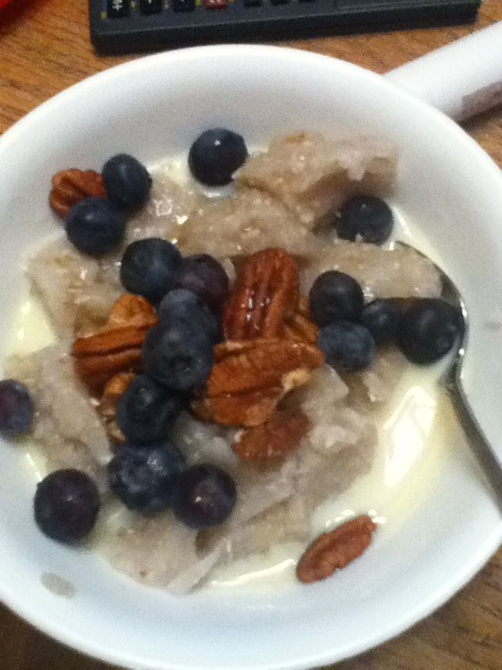 Creamy buckwheat cereal with pecans blueberries and a little agave Yum!