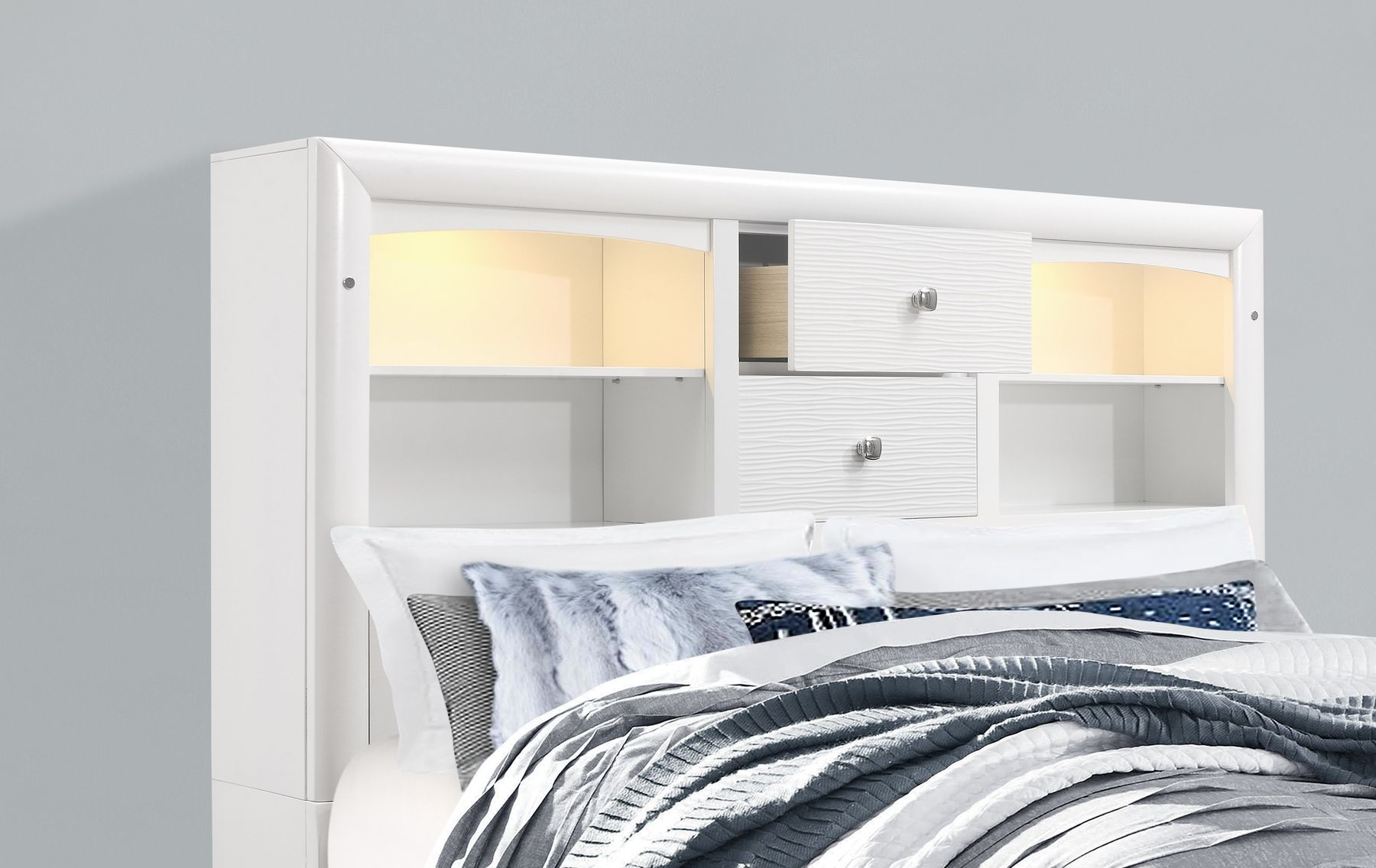 Jordyn (White) price for Full Size Bed, Introducing the Jordyn white storage bed in full size, designed with sturdy construction and contemporary styling. Features include Bookshelf style headboard with LED lighting, 4 spacious footboard drawers, and 2 spacious side drawers. Intricate features include a bar style drawer handles, bracket style feet, and textured drawer fronts which together create this versatile bed fit for any decor style. Choose the Jordyn white bed to upgrade your bedroom inst