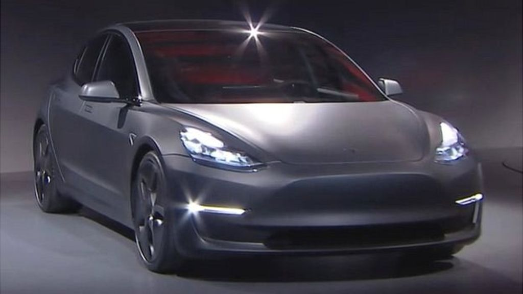 Tesla Unveils Its Much Aned Model 3 Electric Car Saying It Will Cost 35 000 And Have A Range Of At Least 215 Miles 346km Per Charge