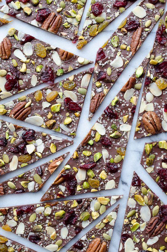 This Hippie Chocolate Bark is amazing! Dark chocolate loaded with fruits, nuts and seeds. Learn how to create chocolate bark with just one baking sheet. | @tasteLUVnourish on TasteLoveAndNourish.com