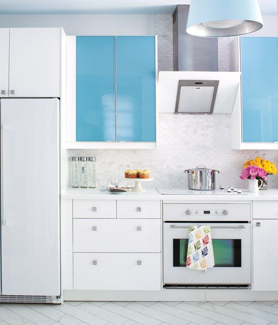 Integrated Euro-style appliances form a seamless look with the white cabinets. {PHOTO: Virginia Macdonald}