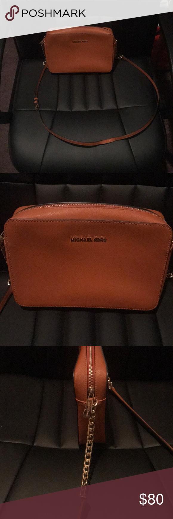 "4a9000fce867 Orange Michael Kors Purse Burnt orange crossbody bag with gold finishings.  Shoulder strap has 22"" drop. Great condition. Michael Kors Bags"